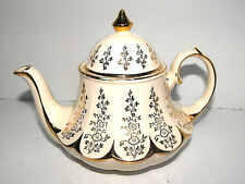 Sadler Rarely Seen Carousel Shaped Teapot Cream With Floral Pattern & Gold Trim