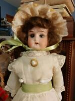 "Antique 14 Inch AM ""Mabel"" Doll In Antique 2-Piece Dress And Decorated Bonnet"