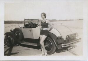 Vintage photo. SASSY WOMAN IN SWIMSUIT W/ CIGARETTE BY CONVERTIBLE SPORTS CAR.