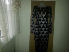 Woman party  pyramid silver dress size small.