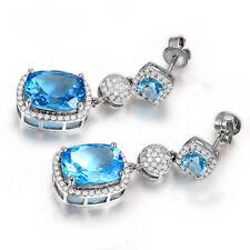 14k White Gold Cushion Blue Topaz & Diamond Dangle Earrings