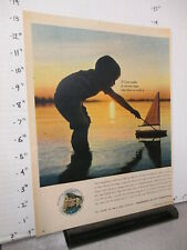 newspaper ad 1961 Prudential insurance little boy lake toy sailboat sunset