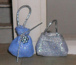 TWO 1/12TH SCALE DOLLS' BLUE BAGS