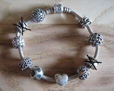 Pandora Armband mit 7 Beads und 1 Clip