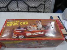 WORLD CUP CAR BATTERY OPERATED TIN CAR LARGE CAR WITH FIGURES.