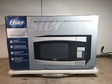 Oster Stainless Steel w/ Black Finish Countertop Microwave Oven model OGYM1401