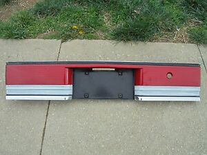 1992 PLYMOUTH ACCLAIM TRUNK TAIL LIGHT PANEL W LICENSE PLATE TRIM OEM