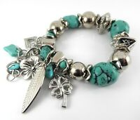 CHUNKY SILVER BRACELET WITH TURQUOISE SEMI PRECIOUS STONE BEADS AND CHARMS