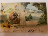 1905 Santa Claus Brown Robe Father Christmas Deer Angel in Cave Postcard Embosse