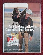 1971 Print Ad Marlboro Man Cigarettes ~ Western Cowboy Shouldering His Saddle