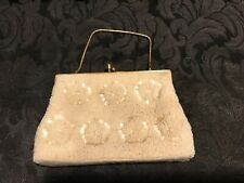 Vintage cream colour beaded evening bag with gold trim. Very good condition.