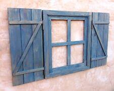 ventana de madera con postigos o contraventanas cruz, azulina, vintage