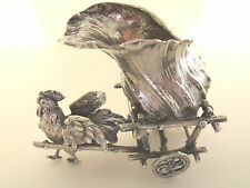 """German """"800"""" silver rooster pulling a cart"""