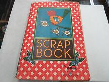 VINTAGE PAPER SCRAPBOOK WITH MAGAZINE CUTOUTS