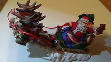 Midwest Importers Santa in Sleigh with two reindeers in the air