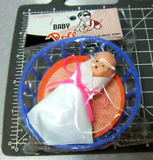 1960s Toy Baby in a Basket, made in Hong Kong still in Cellophane Wrapper