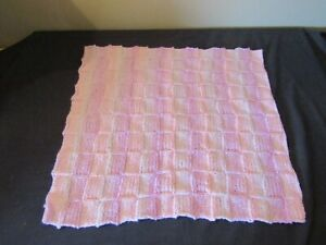 NEW HAND KNITTED BLANKET IN PINK FOR A CRIB, PRAM OR MOSES BASKET.