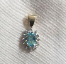 14k two tone oval blue topaz diamond pendant charm