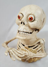 BIG EYES Skeleton Cast Iron Figurine Bank He swallows coins Gothic Halloween