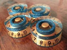 4 Guitar speed volume / tone knobs.. Turquoise Fk/Gold. JAT CUSTOM GUITAR PARTS
