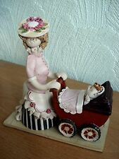 "Laura Dunn Studio Pottery Figurine ""Lady with pram"""