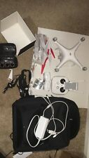 DJI Phantom 4 Quadcopter Drone - with extra battery, case and other accessories