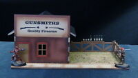 TTCombat - Wild West Scenics - WWS014 - Gunsmiths. Great for Malifaux