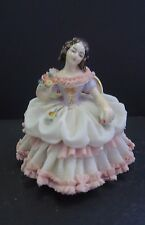 Dresden Germany porcelain Figurine of a seated lady with flowers in lace dress