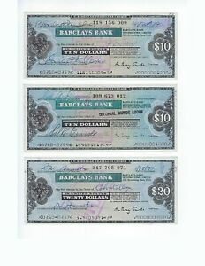 BARCLAYS BANK  USED AND PAID TRAVELERS CHECKS  10$,10$ AND 20$    SET  EF