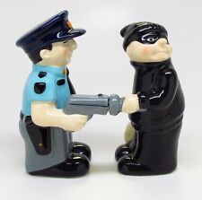 POLICE COP AND THIEF CERAMIC SALT & PEPPER SHAKERS.MAGNETIC ATTACHED