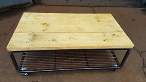 Retro industrial look metal framed wooden topped coffee table with mesh shelf