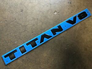 "NEW OEM NISSAN TITAN MIDNIGHT BLACK DOOR EMBLEM ""TITAN V8"""
