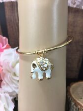 o NWT Swarovski Gold Tone White Elephant Charm Cuff Bracelet