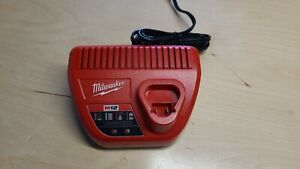 MILWAUKEE M12 BATTERY CHARGER , MODEL # 48-59-2401 Brand New- Never Used