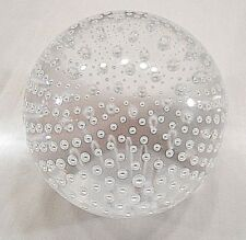CLEAR ROUND PAPERWEIGHT, WITH AIR BUBBLES, FLAT BASE SIGNED