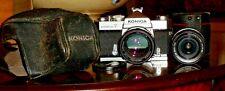 "KONICA AUTOREFLEX ""T"" 35mm CAMERA w/KONICA HEXANON 1:1.4 57mm & AR 28mm 3.5 LENS"
