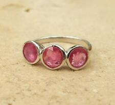 Filling Ruby Three-Stone Fine Rings
