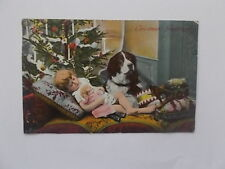 VINTAGE CHRISTMAS CARD POSTCARD - LITTLE GIRL ASLEEP WITH DOG UNDER THE TREE