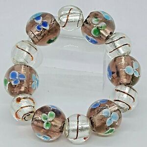 Brown And Clear 12 Glass Bead Expandable Bracelet With Floral Design