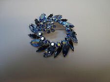 SHERMAN signed HIGH DOMED SHADES OF BLUE CIRCULAR BROOCH/PIN with FLORAL CLUSTER