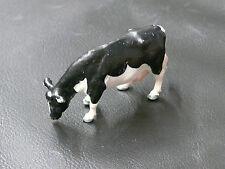 1/32ème BRITAINS : VACHE FRIESIAN MANGEANT / FRIESIAN COW FEEDING - Réf 2148