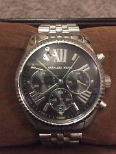 Michael Kors Ladies Lexington Watch. Genuine Silver With Black Dial