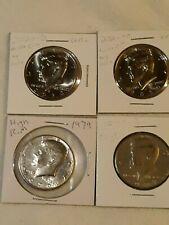 Lot of 4 kennedy half dollars