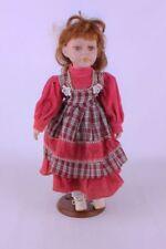 Porzellanpuppe mit rotem Kleid + Ständer  40 cm