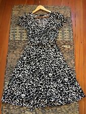BCBG black and white patterned wrap dress size small