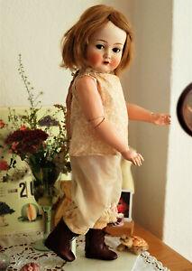"adorable 22"" K&R Simon Halbig 117n flirt eyes bisque head doll from 1915"