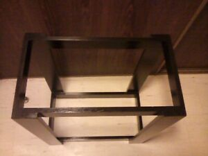 aquarium stand only, black, all wood, foot print is 24x12, holds two 20 gal.