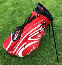 WILSON STAFF STAND CARRY RED GOLF BAG. SIX ZIPPED POCKETS. DOUBLE STRAP