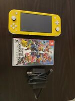 Nintendo Switch Lite Yellow and Super Smash Bros Ultimate and 64 gb micro sd