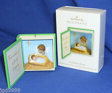 Hallmark Ornament A Child is Born 2012 Angel Baby Jesus in Manger Open Like Book